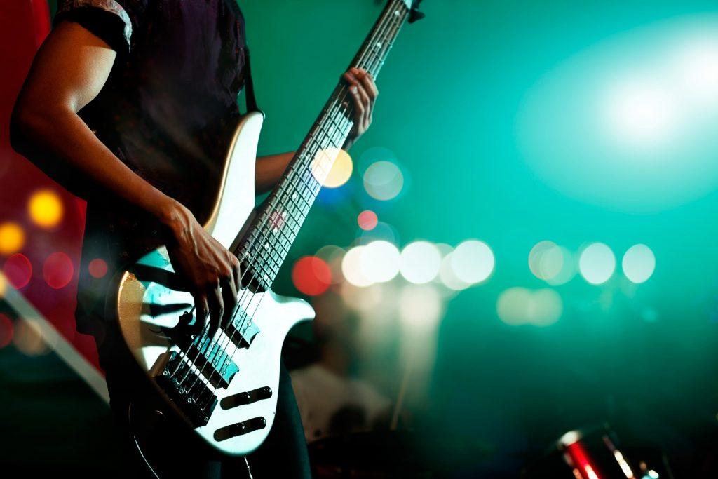 Guitarist on stage during local concert series Pop Nukoonrat 123rf