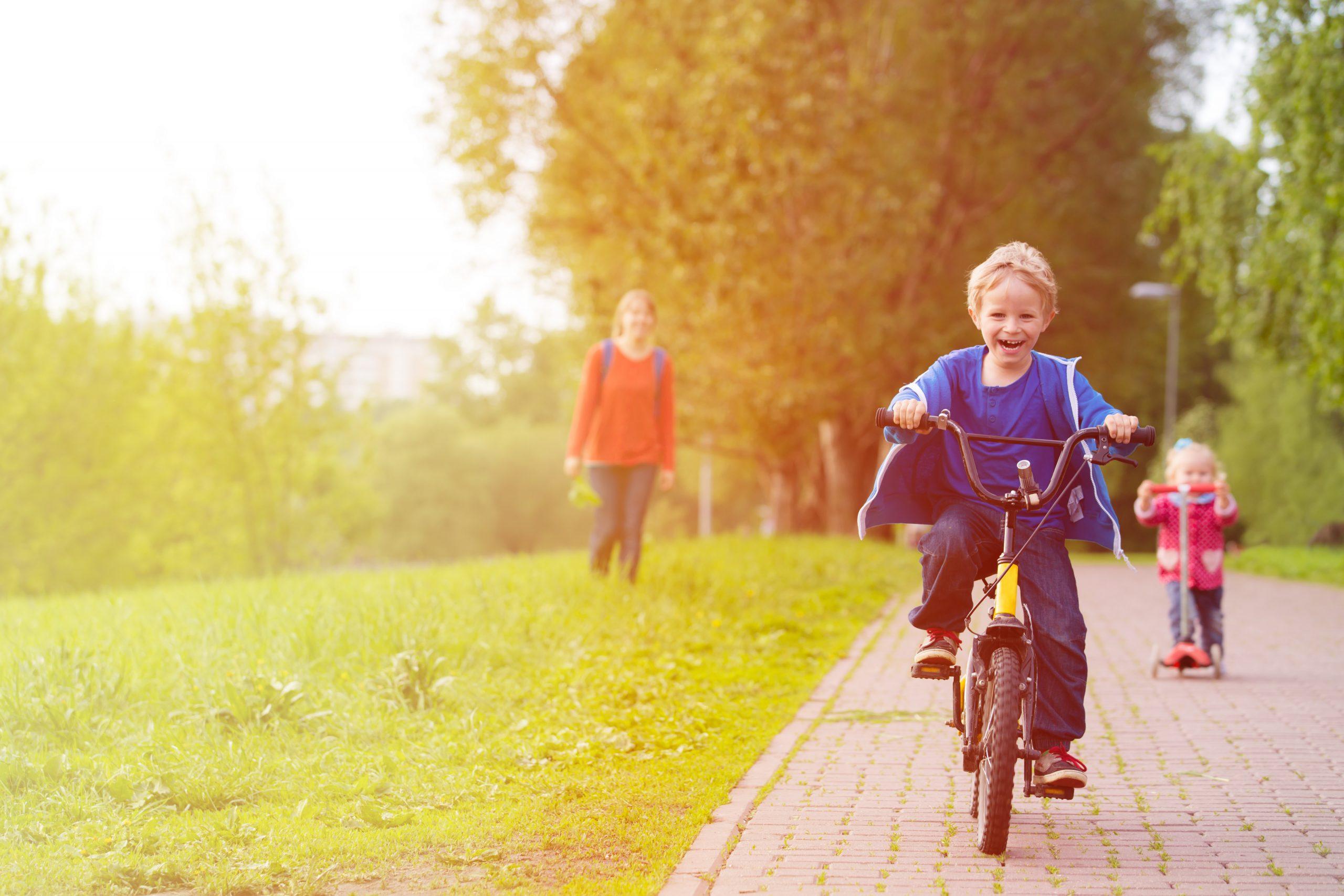 Kid enjoying outdoor activities, like riding a bike