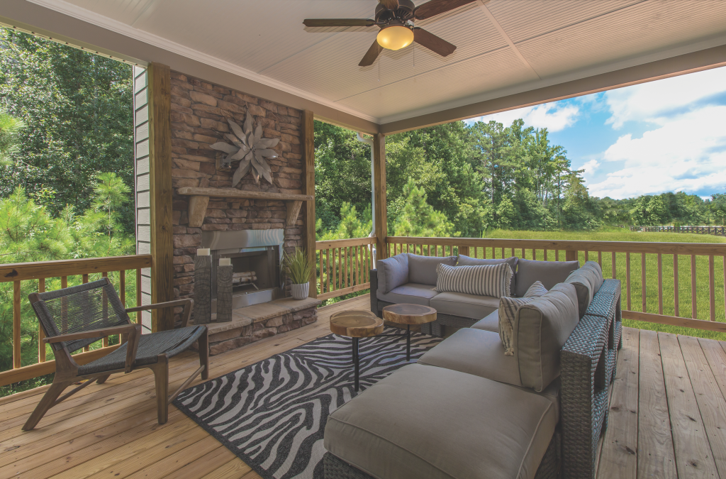 Back porch in Traditions of Braselton with fireplace and beautiful view