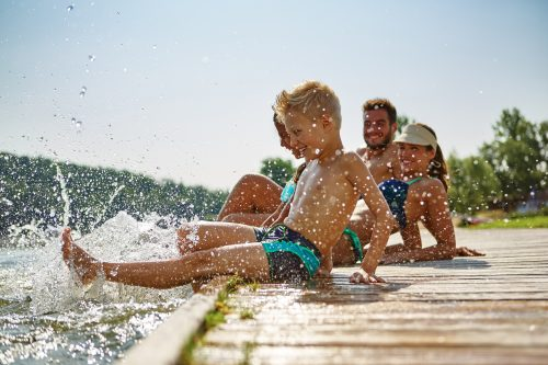 Family having fun and splashing water