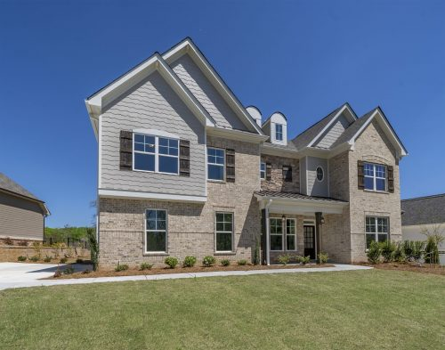 a home with a yard in traditions of braselton